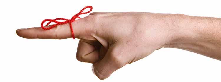 Viser en finger med rød snor om som en slags husjeregel. Billedet er anvendt i blog hos MOTIKON.