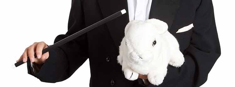Viser en tryllekunster med tryllestav og kanin, Billedet er anvendt i blog hos MOTIKON.